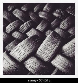 A pile of used car tyres. - Stock Image