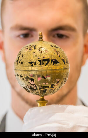 St James's Square, London, UK. 21st May 2019. A pierced brass celestial globe, 16th century, est £100-150,000 - A preview of Christie's Science and Natural History auction which takes place on on 24 May 2019. Credit: Guy Bell/Alamy Live News - Stock Image