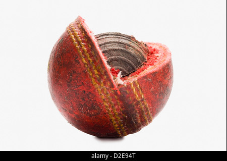 Close-up of a worn out cricket ball - Stock Image