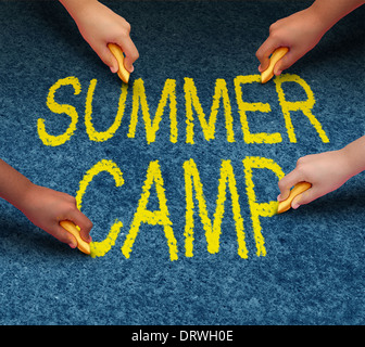 Summer camp with multiethnic school kids drawing words on a pavement outdoor floor as a symbol of recreation and fun education with a group of children working as a team for learning success. - Stock Image