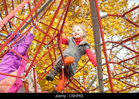 Kids on jungle gym - Stock Image