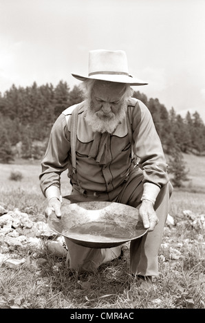 1950s MALE PROSPECTOR PANNING FOR GOLD - Stock Image