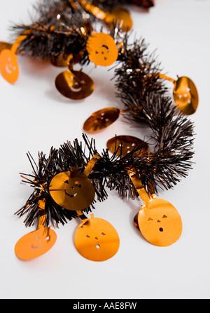 Halloween pumpkin tinsel - Stock Image
