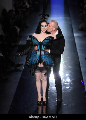 Paris, France. 22nd Jan, 2014. US singer and performer Dita Von Tese (L) and French designer Jean Paul Gaultier (R) acknowledge guests after his show for his spring/summer 2014 collection presented during the Paris Haute Couture fashion week, in Paris, France, 22 January 2014. Paris Haute Couture fashion shows run until 22 January 2014. Photo: Hendrik Ballhausen - NO WIRE SERVICE/dpa/Alamy Live News - Stock Image