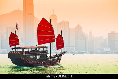 Junk Ship sails in Victoria Harbor in Hong Kong, China. - Stock Image