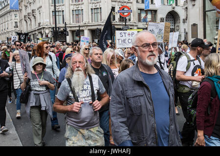 London, UK. 12th Aug, 2017. The Actor Peter Egan, joins the protest organised by the Make Hunting History coalition, the Badger Trust and Care2. Demonstrators marched through central London and rallied outside of Downing Street. Credit: David Rowe/Alamy Live News - Stock Image