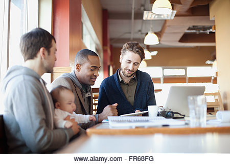 male friends in discussion at lunch - Stock Image