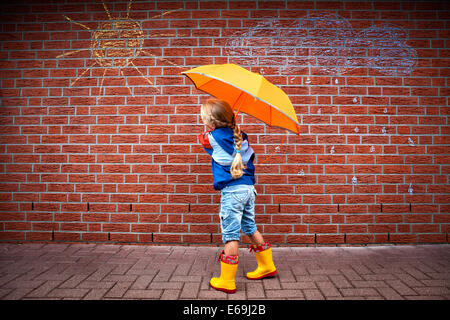 girl,weather,rain protection - Stock Image