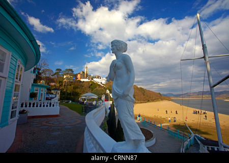 The clock tower and villas of Portmeirion from the grounds of the Portmeirion hotel situated on the sandy banks - Stock Image
