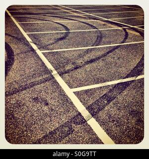 Skid marks in a car park - Stock Image