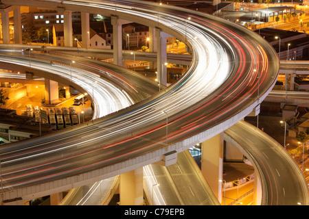 Traffic on Nanpu bridge roundabout at dusk; Dongjiadu: Shanghai; China - Stock Image
