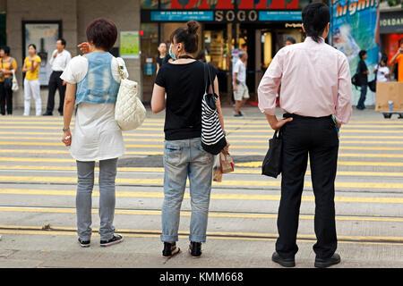 Piétons avec masque facial, île de hong kong, sas, Chine - Image