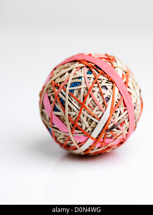 rubber band ball, ball made up of rubber bands wound over each other - Stock Image
