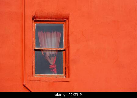 Red wall with window - Stock Image