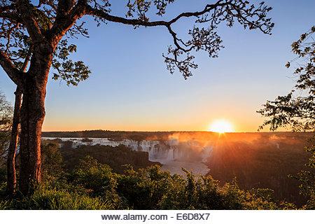 South America, Brazil, Parana, Iguazu National Park, Iguazu Falls against the evening sun - Stock Image