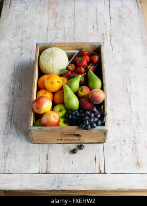 Various fresh fruit in a crate - Stock Image
