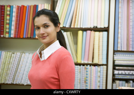 Woman standing in fabric shop - Stock Image