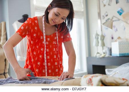 Female seamstress working in home studio - Stock Image