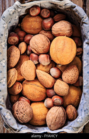 still life with nuts in a basket - Stock Image