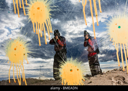Men playing paintball, Sweden. - Stock Image