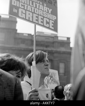A protester at a 1968 demonstration in Trafalgar Square, London against the military regime in Greece. - Stock Image