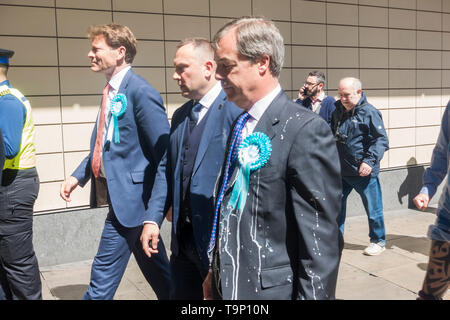 Newcastle upon Tyne, UK. 20th May 2019. UK. Nigel Farage has a milkshake thrown over him while campaigning for the Brexit party in Newcastle city centre. Credit: Alan Dawson/Alamy Live News - Stock Image