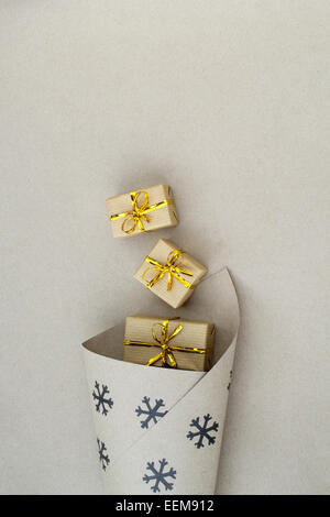 Christmas wrapping paper with gift boxes - Stock Image