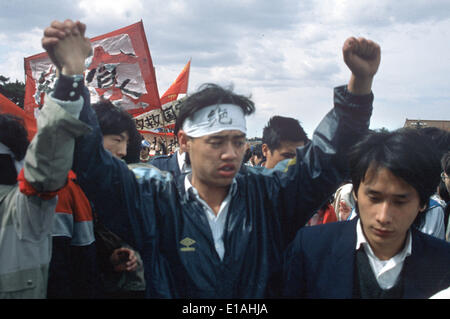 (FILE) - An archive picture, dated 13 May 1989, shows leader of the student protests Wuer Kaixi protesting amongst a crowd of students during a demonstration on Tiananmen Square in Bejing, China. Kaixi wears a headband which reads 'Jueshi' (hunger strike). 25 Years ago, the protests widened in China's captial but were eventually beaten down violently. Photo: Edgar Bauer/dpa - Stock Image