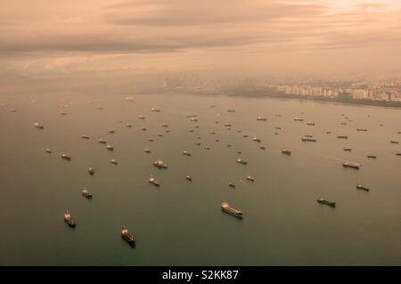 Big ships in front of the coast of Singapore - Stock Image