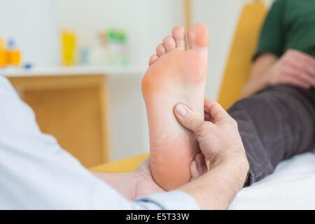 Foot reflexology. - Stock Image