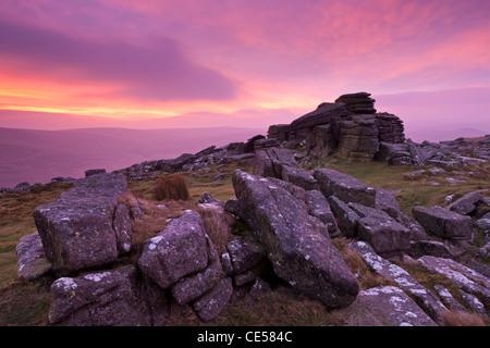 Intense sunrise above Belstone Tor, Dartmoor, Devon, England. Winter (January) 2012. - Stock Image