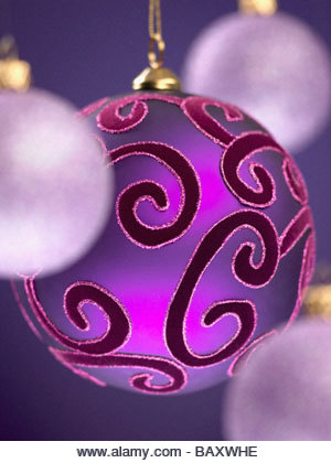 Close up of purple Christmas ornaments - Stock Image
