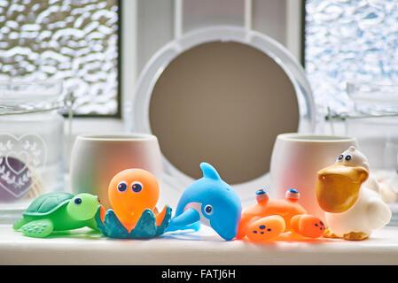 Mutlicoloured Bathroom toys - Stock Image