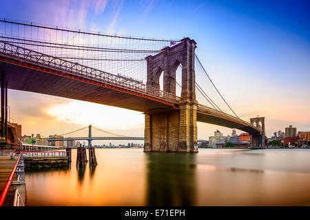 New York City, USA at the Brooklyn Bridge and East River at dawn. - Stock Image