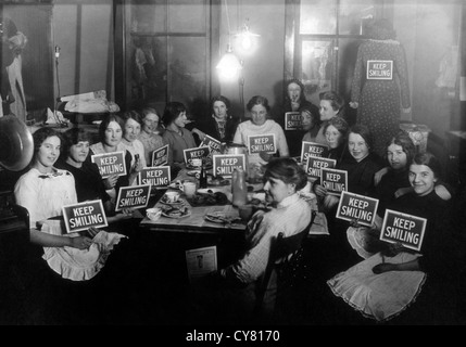 Seamstresses on Lunch Break, Holding Keep Smiling Signs, Circa 1914 - Stock Image