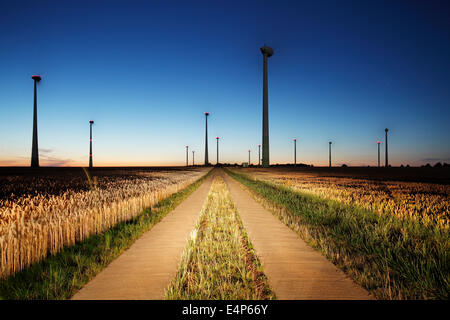 wind turbines on farmland  at night - Stock Image