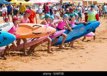 juniors and children from sydney northern beaches surf clubs at newport beach for the surf life saving carnival - Stock Image
