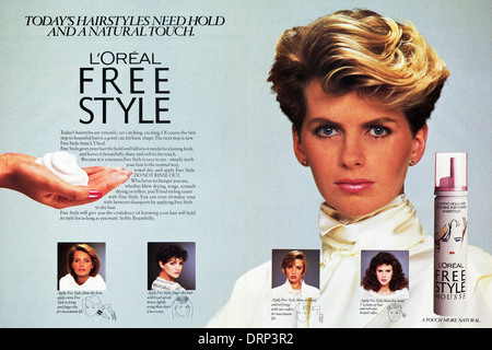 1980s fashion magazine double page advertisement advertising L'OREAL FREE STYLE MOUSSE for hair, advert circa 1983 - Stock Image