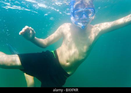 Teenager snorkeling in the water of Salto(Saltö) Sweden - Stock Image