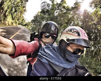 Traveller selfie on motorcycle - Stock Image