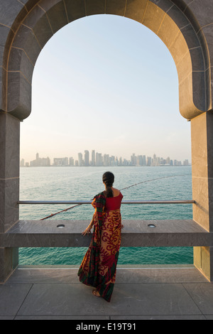 Doha. Qatar. Vistitor looking across Bay of Doha from the Museum of Islamic Art. - Stock Image