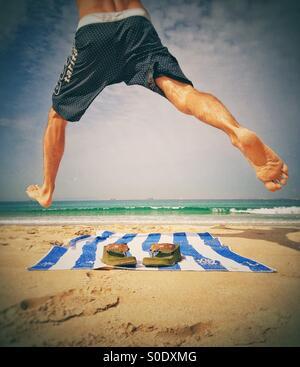 Man enjoying at the beach - Stock Image