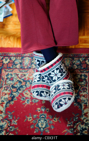 Elderly Lady Wearing Slippers. - Stock Image