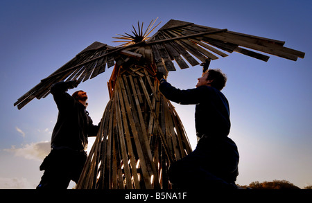 Finishing touches to the bonfire night celebrations in East Hoathly, an angel tops the bonfire.  Picture by Jim - Stock Image