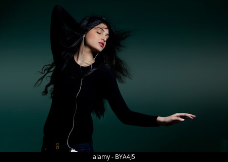 Girl listening to music - Stock Image
