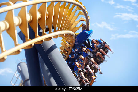People riding amusement park ride - Stock Image