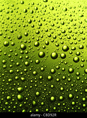 Texture of water drops on the bottle of beer. - Stock Image