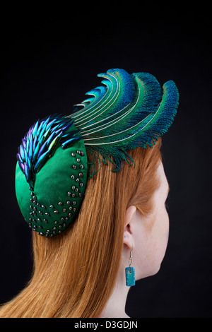 An organic hat modeled on a redhead. Handmade by Catherine Povey Milinery, Llandeilo, Carmarthenshire. - Stock Image
