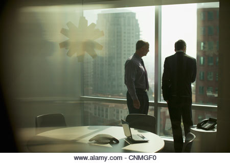 Businessmen working together in office - Stock Image