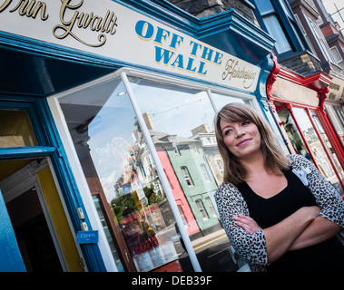 Kimberley Michelle Lewis, self employed owner of Off The Wall hair salon, Northgate St, Aberystwyth, standing outside her shop - Stock Image